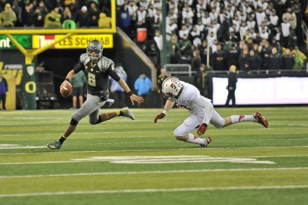 Marcus Mariota gets away from a Stanford player.