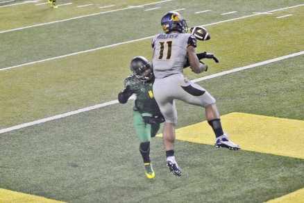 Dargan separates Cal receiver from the ball.
