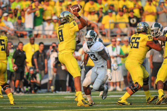Marcus Mariota evading pressure from the Michigan State defense.