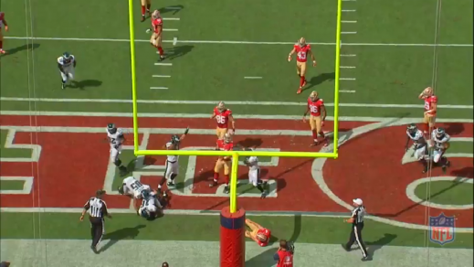 The right guard has to pick his poison, so he chooses to block Braman. Burton comes free at the punter and the result is a blocked punt picked up by Smith in the endzone for a touchdown.
