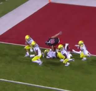 Joe Walker starts flying down-field accompanied by a mob of Ducks protecting him from Utes for 100 yards.