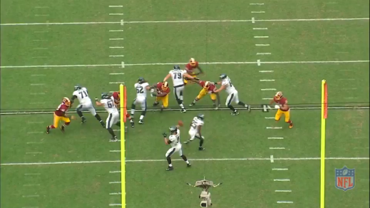 As quarterback Nick Foles releases the ball, Kelce sheds the nose tackle and gets ready to form another wall.