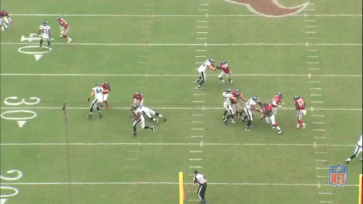 Kelce uses his whole body to cut block the linebacker and take him out of the play.