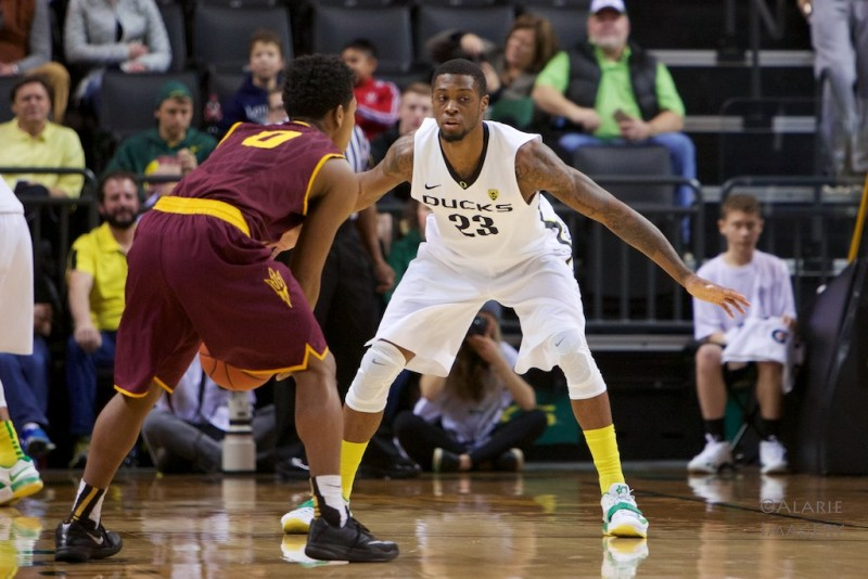 Elgin Cook playing some defense against Arizona State. Photo by: Donald Alarie