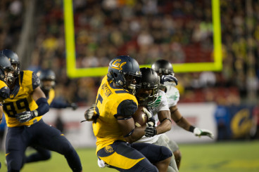 Nelson makes a tackle on a California Golden Bears punt returner in one of his appearances on defense last season.