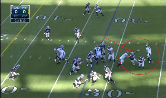 Dallas' Jeremy Mincey deep in the backfield just after the handoff
