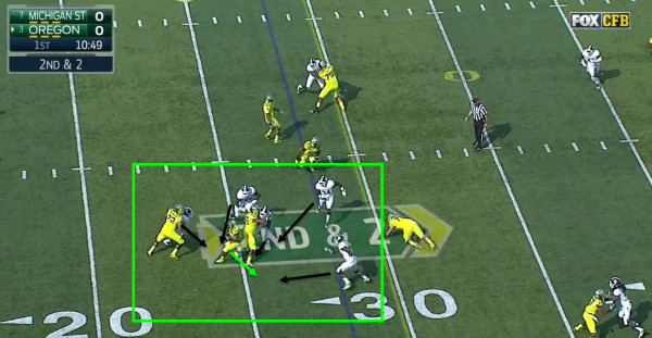 Tyner has nowhere to go with the ball and is dropped for a loss.