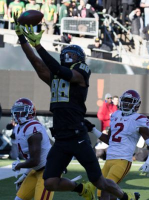 This Duck (Dwayne Stanford) flies high for a TD over hapless Trojans.