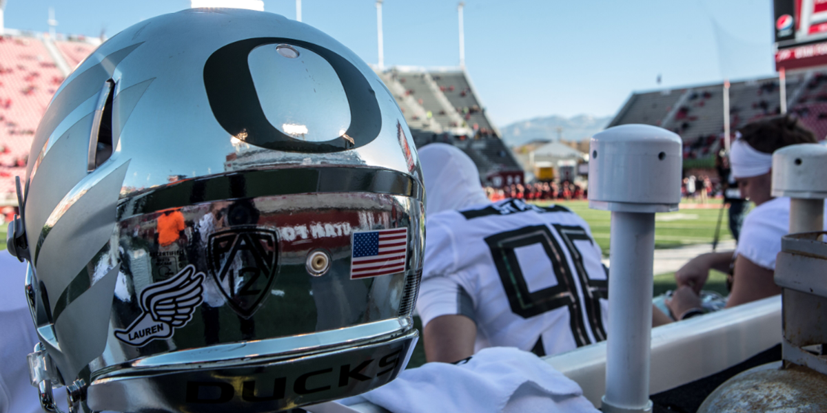 A reflective silver Oregon Ducks football helmet.